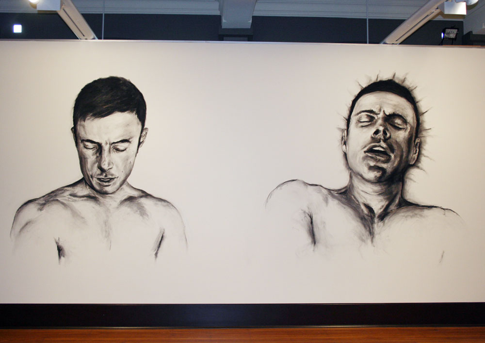 (left) Luke Thurgate, Self portrait as top, 2010, Charcoal wall drawing Dimensions variable (right) Luke Thurgate, Self portrait as bottom, 2010, Charcoal wall drawing Dimensions variable