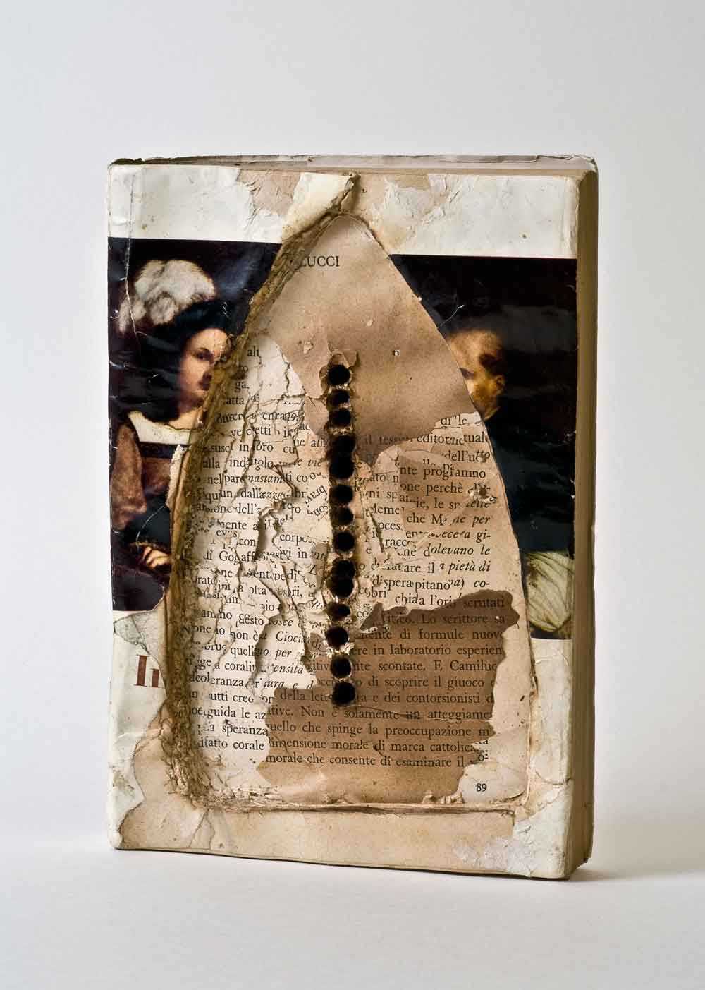 Elisabetta Gut, 14 Nails (The imprint of ManRay) (Book-object, 1991, assemblage: book found, drilling with nails, burning with iron 23 x 23.5 cm