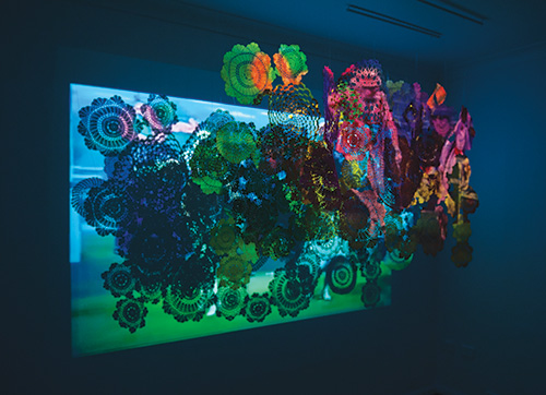 Kiri Morcombe, There's something about pattern I, 2011, doilies and video, dimensions variable, photo by Alex Wissser