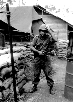 Sapper Terry Lorraine outside accommodation tent after transport patrol, 17 construction unit, Nui Dat, 1968 (Image courtesy James Lorraine, photograph reproduced by Neville Foster, 1997) Silver gelatin print 30.3 x 40.5cm