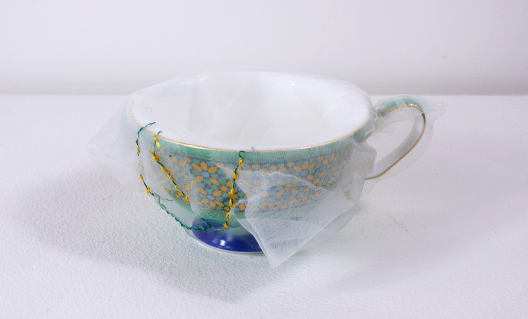 (image) Kei Takemura, Renovated yellow and green teacup, 2015, Italian synthetic cloth, Japanese silk thread, 6 x 10cm, Image courtesy of Dominik Mersch Gallery.
